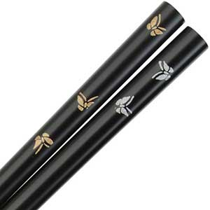 Butterflies of Gold and Silver on Black Japanese Chopsticks Black lacquered Japanese chopsticks with gold and silver butterflies. This Japanese chopstick is 9 inches long with blended profile handles and smooth tips. Made in Japan.